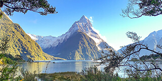 Image of Mitre Peak at Milford Sound on a blue sky day