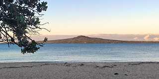 Image taken from Mission Bay at sunrise looking across to Rangitoto