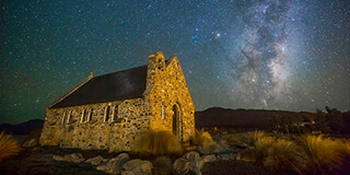 Image of the iconic Church of the Good Shepherd at Lake Tekapo taken at night with the Milky Way in the background