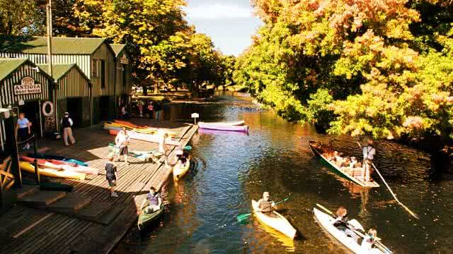 Image of the Antigua Boat sheds in Christchurch where you can go punting on the River Avon