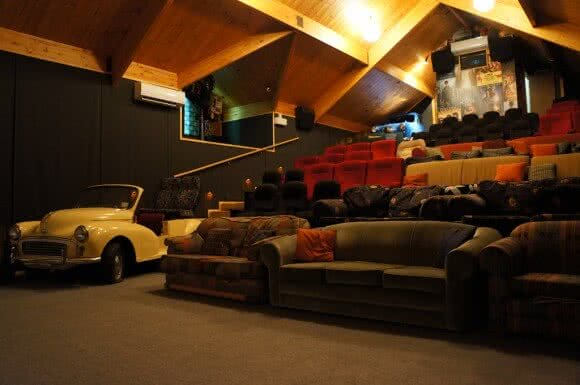 Image showing the inside of Cinema Paradiso in Wanaka New Zealand with old sofas and a seat made out of an old car