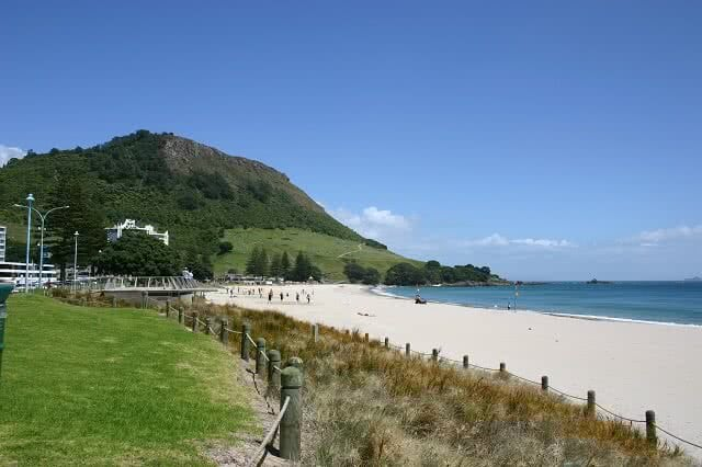 Image of the beach at Tauranga with Mount Maunganui in the background
