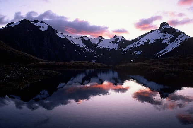 Image looking towards Mount Ernot and Jervois Glacier at sunset on the Milford Track - one of New Zealand's Great Walks
